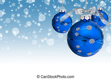 Blue Baubles - Hanging blue holiday ornaments with...