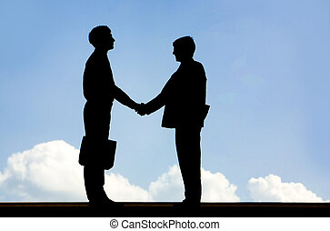 Business deal - Image of silhouette business partners...