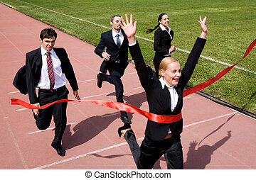 Winning - Photo of businesspeople crossing the finish line