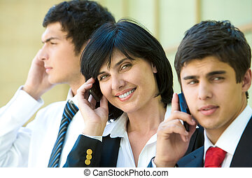 Business agents - Row of three agents calling by their...