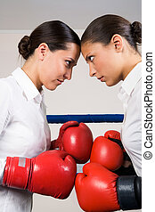 Fight - Photo of aggressive business women in boxing gloves...