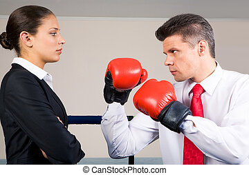 Unequal fight - Portrait of aggressive businessman in boxing...