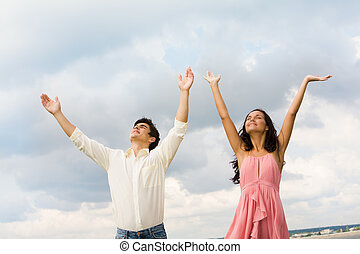 Praising couple - Portrait of happy couple standing with...