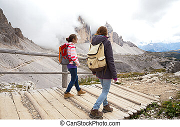 tourist girl at the Dolomites - hiker girls are walking...