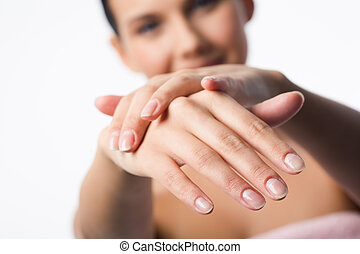 Handcare - Image of female manicured hands on background of...