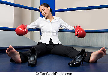 Tiredness - Portrait of tired businesswoman in boxing gloves...