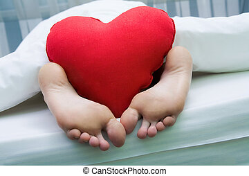 Feet with heart - Image of bare feet with red soft...
