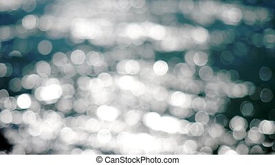 Beautiful abstract blue glittering lights bokeh background -...