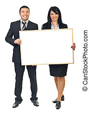 Two business people holding banner - Two smiling business...