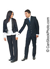 Sexual harassment - Smiling business man touching back of a...