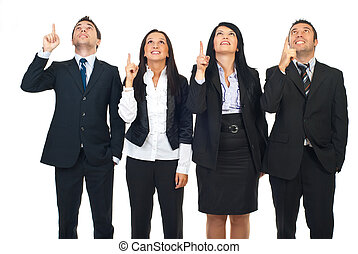 Group of people pointing up - Group of four business people...
