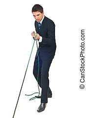 Businessman trying hard to pulling rope - Full length of...