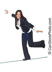 Business woman walk on tightrope - Business woman walking on...