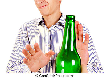Man refuse a Beer - Young Man refuse a Bottle of the Beer on...