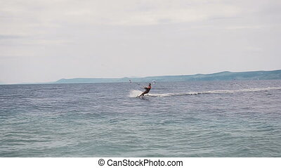 Kite surfer rides on the waves of the Adriatic Sea. Croatian...