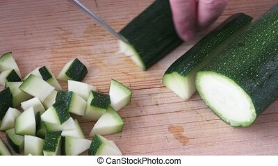 Cut zucchini on chopping board for cooking