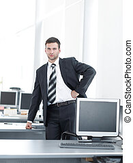senior Manager standing in a modern office before the start...