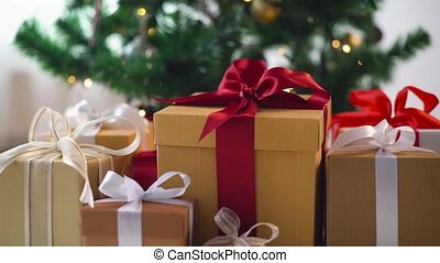 hands taking gift box from under christmas tree - holidays,...