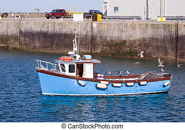 Fishing Boat - A fishing boat coming into harbour. Focus on...