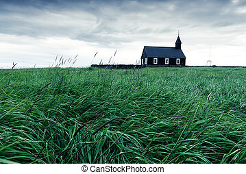 Black wooden church Budakirkja at Snaefellsnes, western...