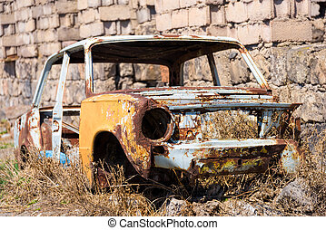 Abandoned and rusty skeleton of a Soviet Russian car by the...