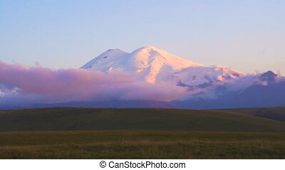 Timelapse sunset with clouds in the mountains Elbrus, Northern Caucasus, Russia. 4k UHD video