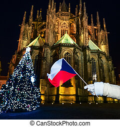 Closeup on woman in Christmas Prague showing Czech flag