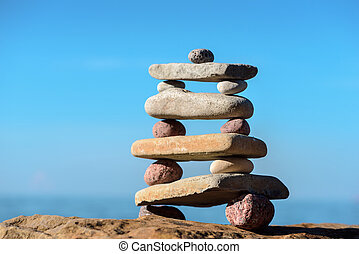 Stable stack of pebbles - Balancing several of stones on the...