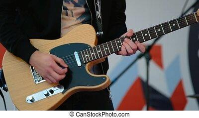 Man playing electric guitar close up