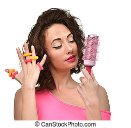 brunette woman with big pink hair brush and scrunchy looking...
