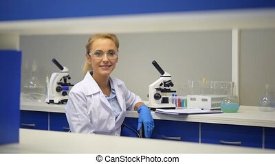 Joyful scientist grinning broadly into camera - Positive...