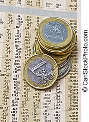 Euro coins on a financial newspaper