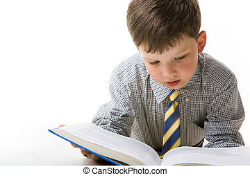 Diligent pupil - Photo of smart pupil reading textbook over...
