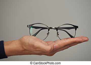 Glasses on human hand - Glasses on human lay hand close up...