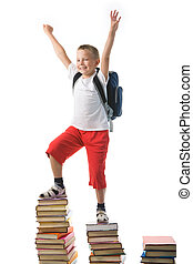 Success - Diligent preschooler standing on the top of book...