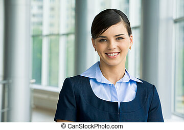 Successful woman - Portrait of happy leader looking at...