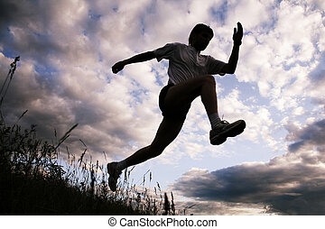 Silhouette of sportsman - Photo of silhouette of jumping...
