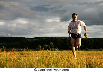 Sport training - Portrait of strong man running and looking...