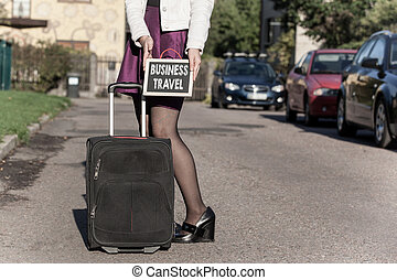Business Travel concept. woman with travel bag on the...