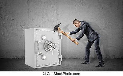 A businessman on concrete background fails to destroy a...