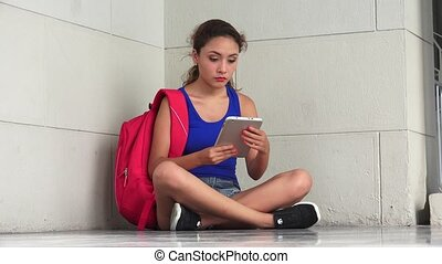 Confused Hopeless Female College Student With Tablet