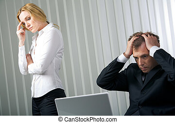 Default - Photo of stressed businessman touching his head...