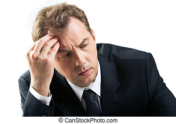 Stress - Photo of stressed businessman touching his head...