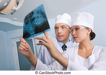 Showing x-ray photography - Image of young lady with dentist...