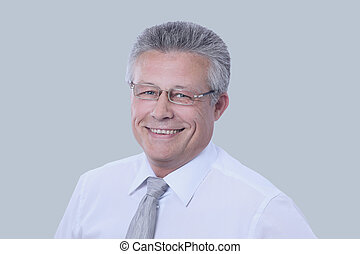 Gray-haired business man smiling isolated on gray...