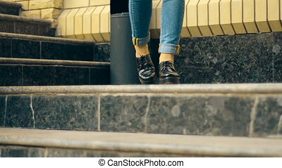 girl goes down the stairs - stylish girl goes down the...