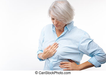 Grey-haired woman suffering from stomachache - Acute pain....