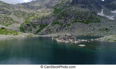 aerial view of lake in mountains - aerial view of beautiful...