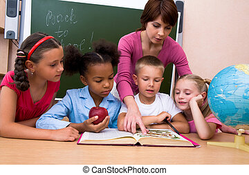 Explaining - Portrait of woman teaching children and...