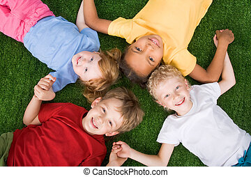 Group of children - Photo of group of children lying on the...